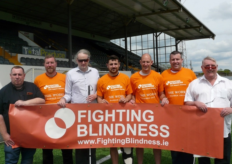 Eric Beggs at Dundalk FC with Fighting Blindness banner