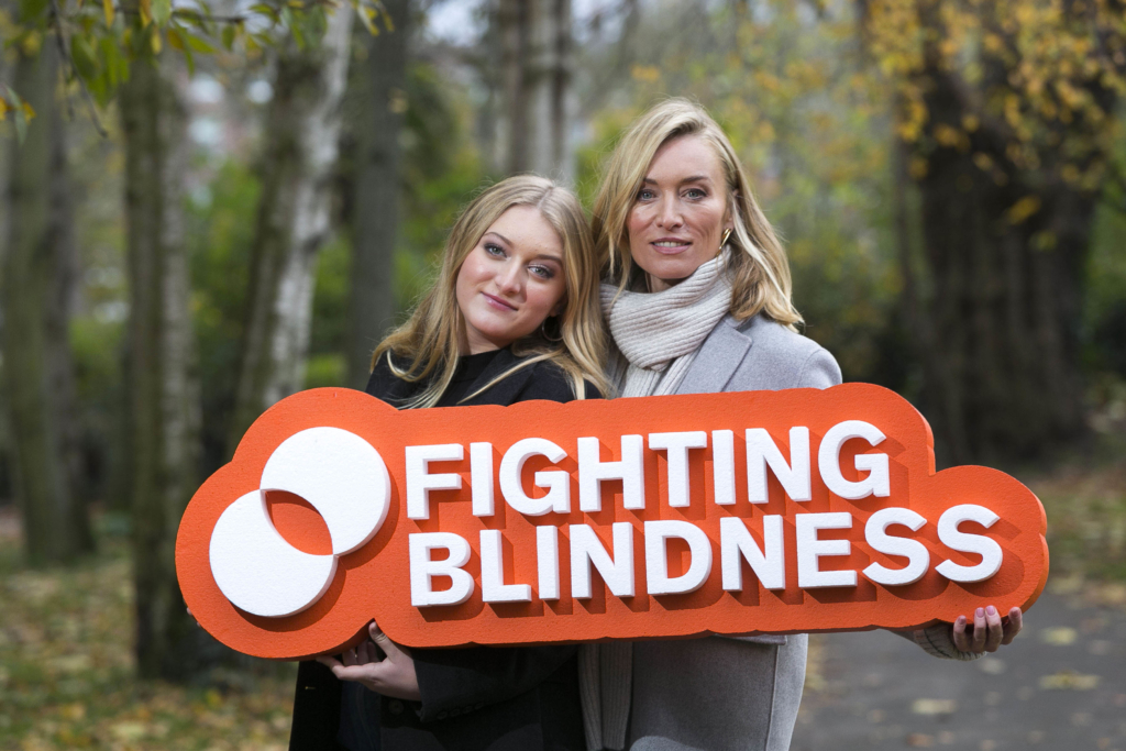 Victoria Smurfit and her daughter Evie holding a FB sign