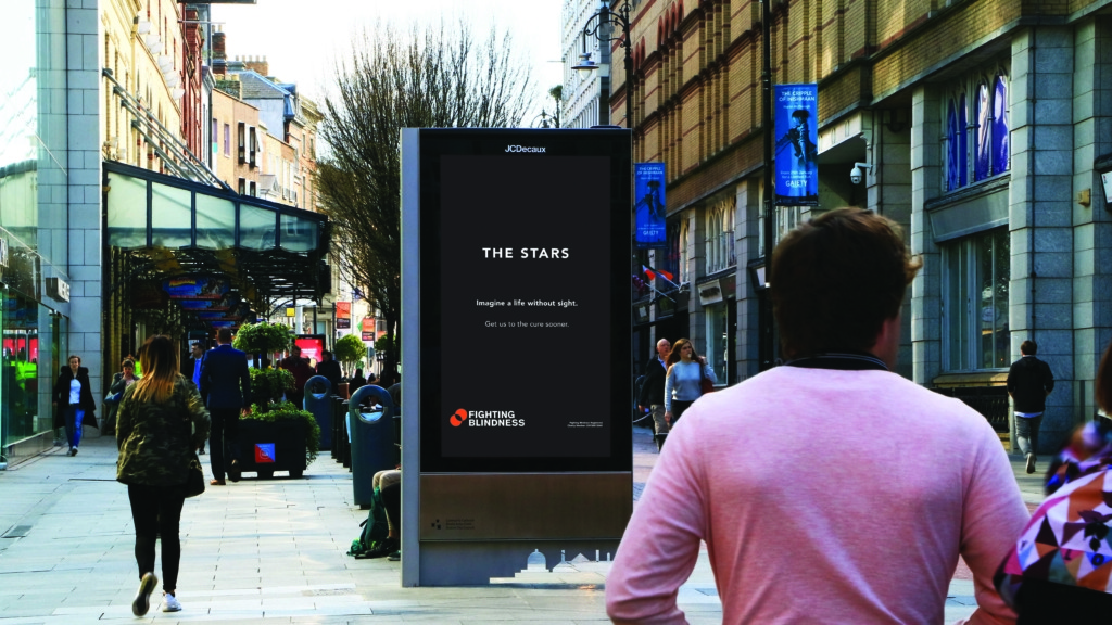 Street shot of new Fighting Blindness creative campaign in situ