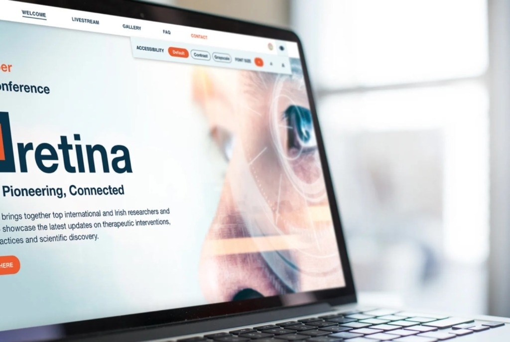 Image of our retina.ie website on a laptop by a window